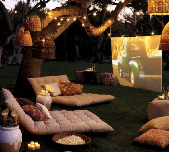 outdoor-cinema-with-soft-furishings-and-tree-lighting-600x540